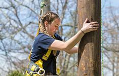 A Penn State Mont Alto competes in a pole climbing competition