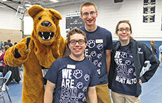 Lion Ambassadors pose with the Nittany Lion
