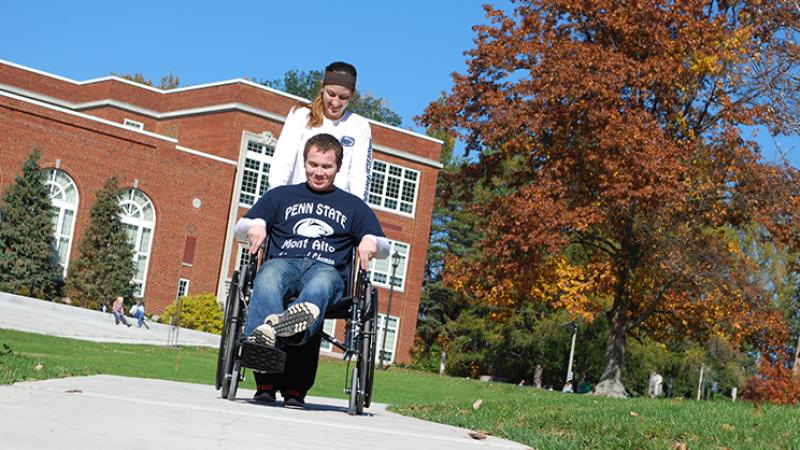 PTA Students practice hands-on skills with a wheelchair