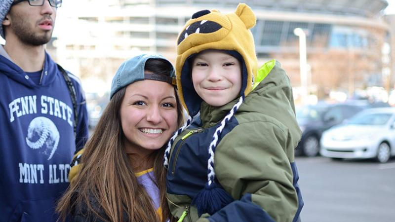 THON Dancer Keighley Taylor holds THON benefits recipient Austin Lightner