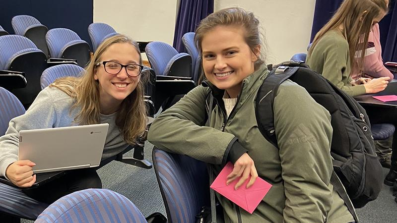 Female students collaborate in auditorium