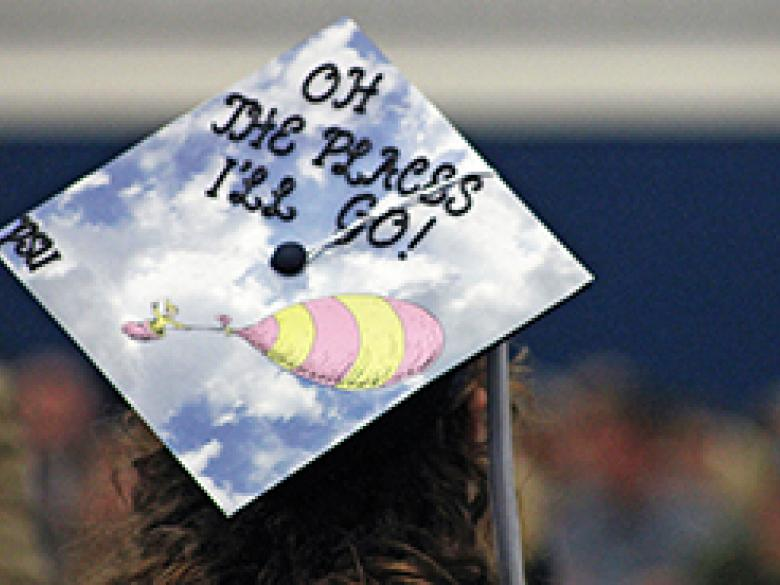A Penn State Mont Alto grad dons a decorated mortar board at commencement