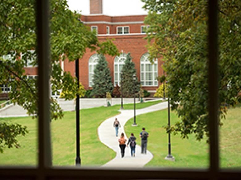 View from Mill Cafe of students walking across quad in middle of campus