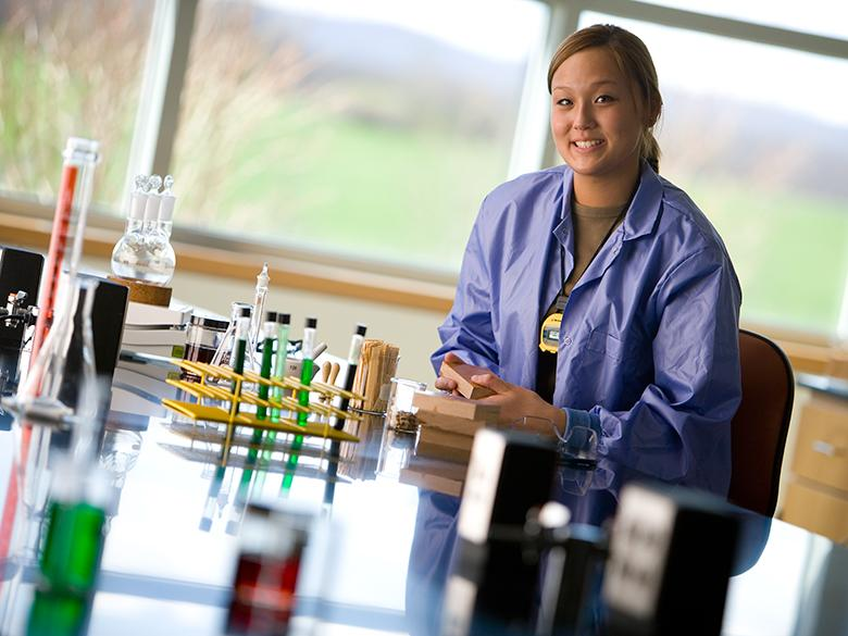 Penn State student sits in a lab