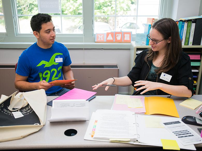A Penn State Mont Alto adviser helps a student with paperwork.