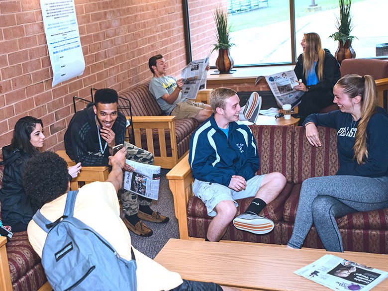 Penn State students share conversation in lounge area