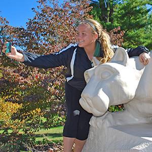 Student takes selfie at Lion Shrine