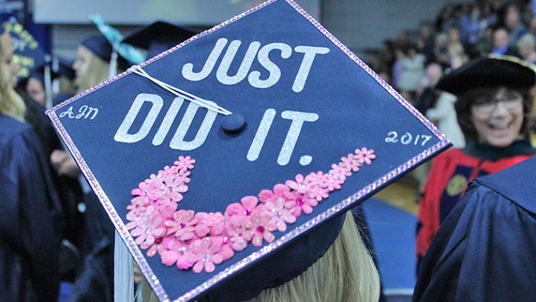 "Graduate cap with ""Just did it"" decoration"