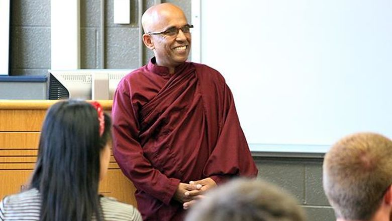 The Venerable Bhante Sujatha, a Buddhist monk, speaks to a class at Penn State Mont Alto