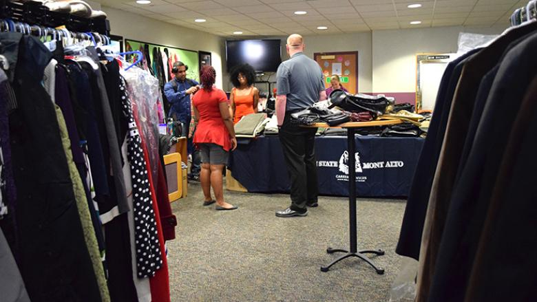 "Students ""shop"" for donated business attire at Career Closet"