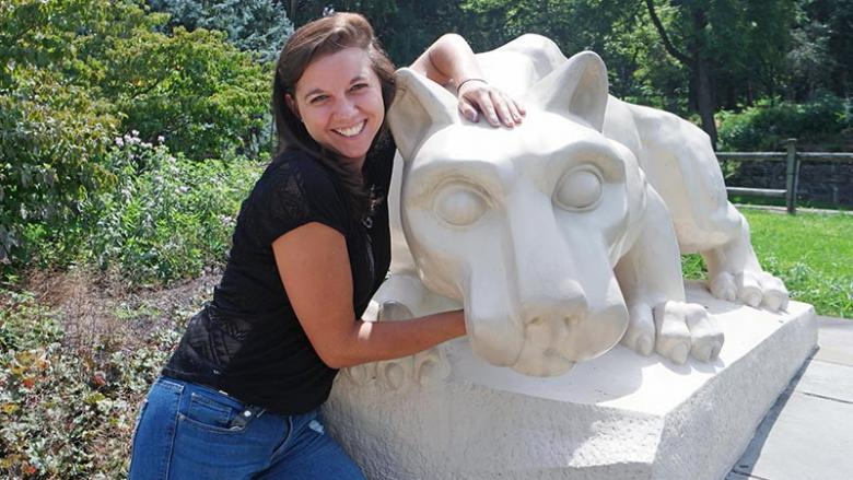 Courtney Stump poses with Lion Shrine at Penn State Mont Alto